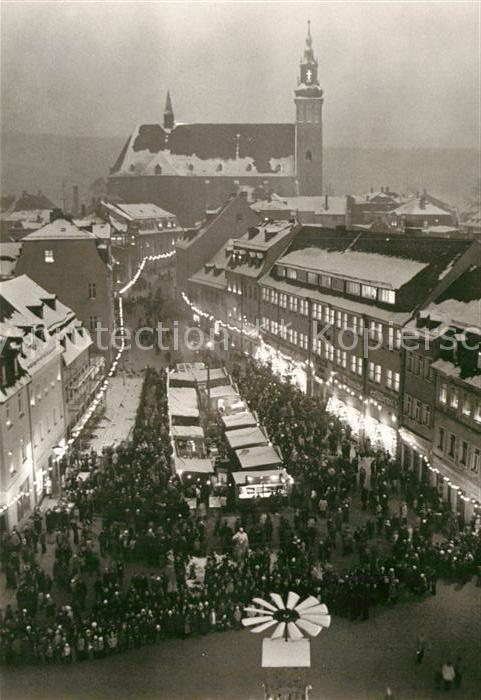 AK / Ansichtskarte Schneeberg Erzgebirge zur Weihnachtszeit Weihnachtsmarkt Kirche Kat. Schneeberg