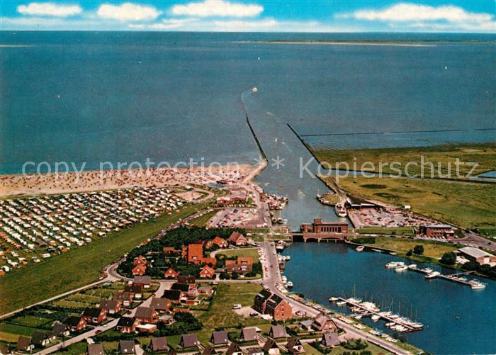 AK / Ansichtskarte Carolinensiel Ostfriesland Fliegeraufnahme mit Hafen und Strand Kat. Wittmund