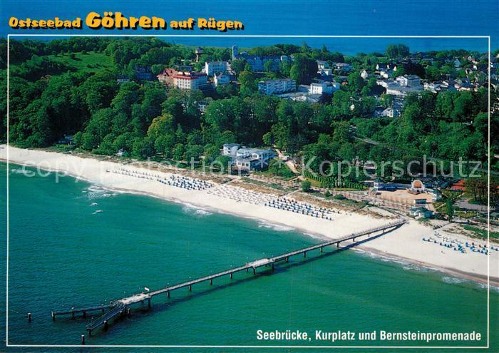 AK / Ansichtskarte Goehren Ruegen Fliegeraufnahme Seebruecke Kurplatz und Bernsteinpromenade Kat. Goehren Ostseebad Ruegen