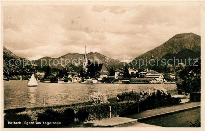 AK / Ansichtskarte Rottach Egern Uferpartie am See Ortsansicht mit Kirche Alpen Kat. Rottach Egern