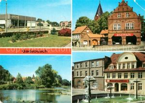 AK / Ansichtskarte Gadebusch Konsum Kaufhalle Rathaus Burgsee Markt Kat. Gadebusch