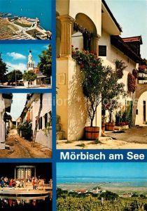 AK / Ansichtskarte Moerbisch See Seebuehne Fliegeraufnahme Hauptstrasse Seitengasse Bauernhaus Panorama Kat. Moerbisch am See