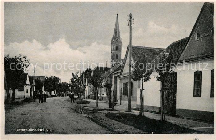 AK / Ansichtskarte Unterpullendorf Dorfstrasse Kirche