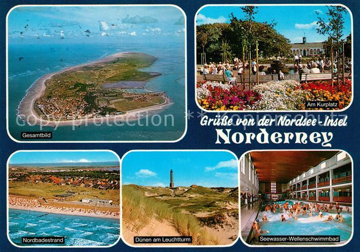 AK / Ansichtskarte Norderney Nordseebad Kurplatz Duenen Leuchtturm Seewasser Wellenschwimmbad Strand Fliegeraufnahme Kat. Norderney