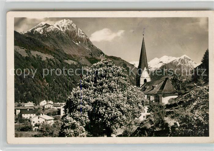 AK / Ansichtskarte Matrei Osttirol Ortsmotiv mit Kirche Baumbluete Alpenblick Kat. Matrei in Osttirol