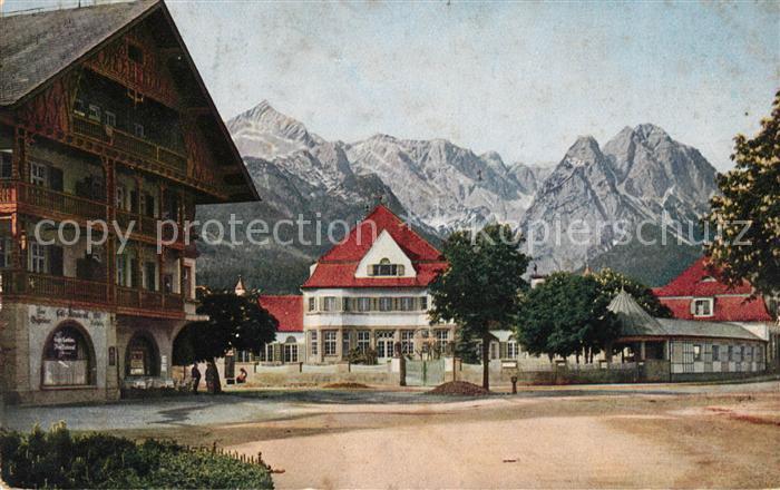 AK / Ansichtskarte Garmisch Partenkirchen Marktplatz gegen Alpspitze Zugspitze Wettersteingebirge Kat. Garmisch Partenkirchen