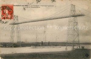 AK / Ansichtskarte Rochefort sur Mer Le Croiseur Surcouf passant sous le Transbordeur Kat. Rochefort Charente Maritime