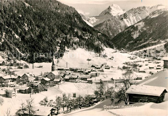 AK / Ansichtskarte Gaschurn Vorarlberg Gesamtansicht mit Alpenpanorama im Winter Kat. Gaschurn