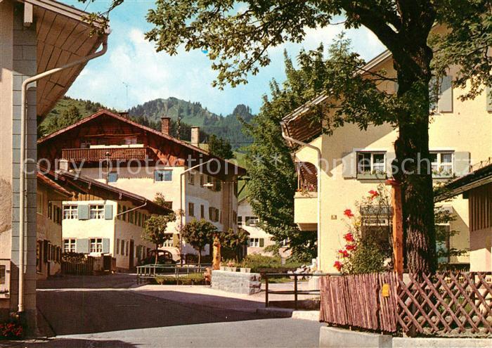 AK / Ansichtskarte Nesselwang Dorfstrasse Reuter wanne An der Riese Kat. Nesselwang