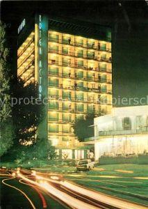 AK / Ansichtskarte Slatni Pjassazi Hotel Astoria Nachtaufnahme
