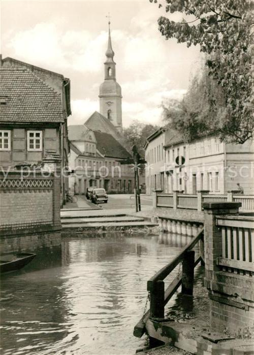 AK / Ansichtskarte Luebbenau Spreewald Partie am Wasser Blick zur Kirche Kat. Luebbenau