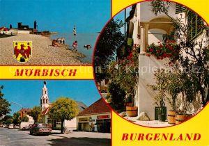 AK / Ansichtskarte Moerbisch See Festspielbuehne Heimathaus Hauptstrasse katholische Pfarrkirche Kat. Moerbisch am See