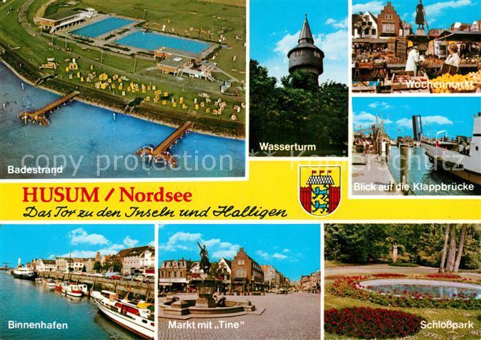AK / Ansichtskarte Husum_Nordfriesland Fliegeraufnahme Schwimmbad Badestrand Park Wasserturm Husum Nordfriesland Kat. Husum