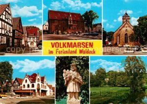 AK / Ansichtskarte Volkmarsen Altstadt Fachwerkhaeuser Hotel Restaurant Rathaus Kirche Denkmal Partie am Fluss Volkmarsen
