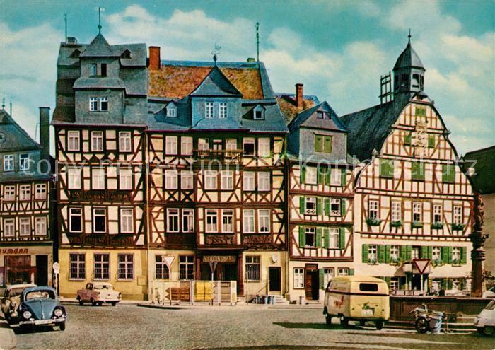 AK / Ansichtskarte Butzbach Marktplatz Rathaus Brunnen Fachwerkhaeuser Altstadt Butzbach