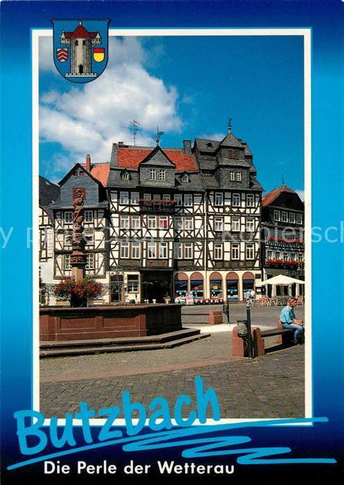 AK / Ansichtskarte Butzbach Brunnen Marktplatz Fachwerkhaeuser Altstadt Butzbach