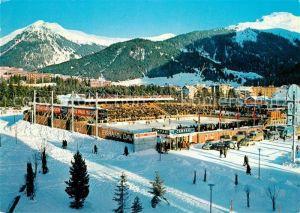 AK / Ansichtskarte Davos_GR Hockey Match auf Kunsteisbahn Davos_GR