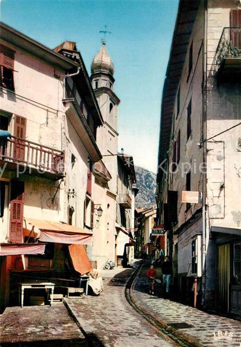 AK / Ansichtskarte Saint Martin Vesubie Chapelle des Penitents Blancs Ruisseau sur rue centrale Saint Martin Vesubie