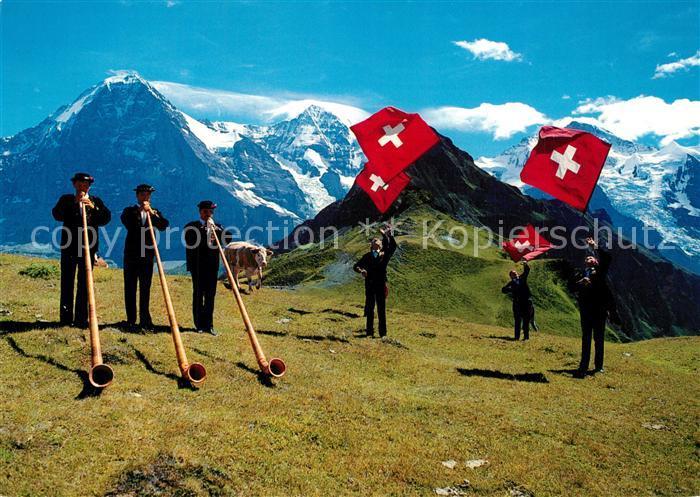 AK / Ansichtskarte Alphorn Alphornblaeser Fahnenschwinger Eiger Moench Jungfrau Alphorn