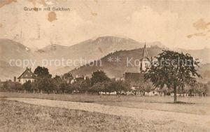AK / Ansichtskarte Grunern Ortsansicht mit Kirche Blick zum Belchen Schwarzwald Grunern