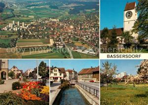 AK / Ansichtskarte Bassersdorf Kirche Platz Bachlauf Baumbluete Fliegeraufnahme Bassersdorf