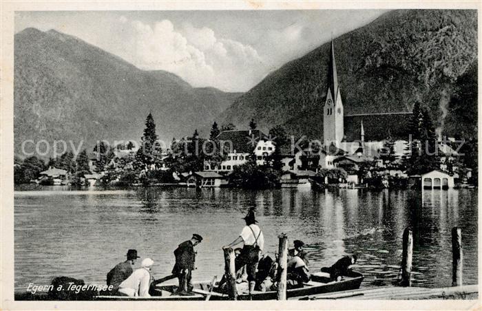 AK / Ansichtskarte Egern_Tegernsee Partie am See Blick zum Ort mit Kirche Alpen Egern Tegernsee