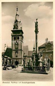 AK / Ansichtskarte Komotau Stadtkirche Dreifaltigkeitssaeule Komotau