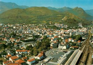 AK / Ansichtskarte Lourdes_Hautes_Pyrenees Vue generale aerienne La Gare La Basilique Eglise du Sacre Coeur Lourdes_Hautes_Pyrenees