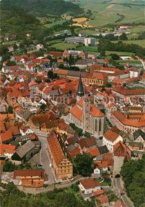 AK / Ansichtskarte Muennerstadt Fliegeraufnahme mit Stadtpfarrkirche St Maria Magdalena Muennerstadt