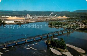 AK / Ansichtskarte Prince_George_British_Columbia Bird s eye view of the industry of the north Oil refinery sharp Fraser River Nechako River Bridge Prince_George