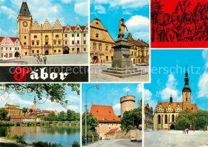 AK / Ansichtskarte Tabor_Suedboehmen Marktplatz Denkmal Kirche Stadtmauer Turm Uferpartie am Wasser Tabor Suedboehmen