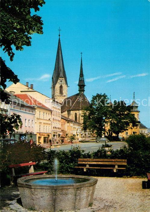 AK / Ansichtskarte Bad_Leonfelden Ortspartie mit Brunnen und Kirche Bad_Leonfelden