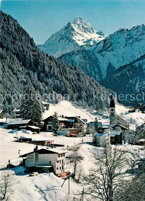 Gaschurn_Vorarlberg Ortsansicht mit Kirche Blick zur Vallula Winterpanorama Alpen Gaschurn Vorarlberg