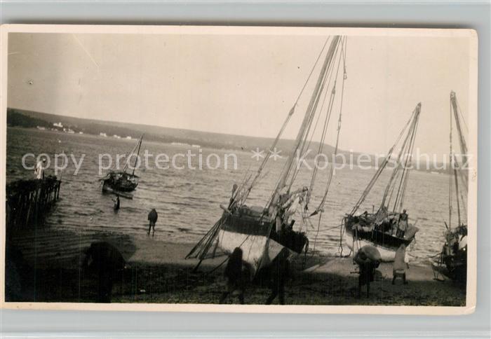AK / Ansichtskarte Mikindani Segelboote Dhows beim Ausladen der Rinde