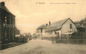AK / Ansichtskarte La_Bassee Rue de la Gare et le Passage a niveau La_Bassee