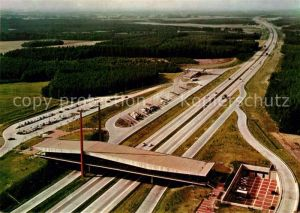 AK / Ansichtskarte Autobahn Bundesautobahn Br?ckenrasthaus Dammer Berge Fliegeraufnahme Holdorf