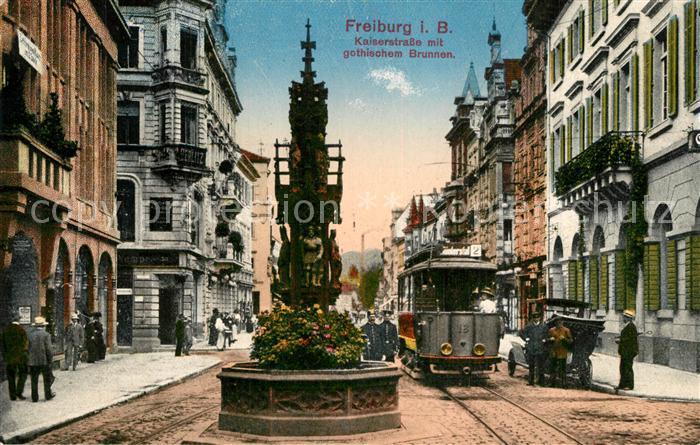 AK / Ansichtskarte Freiburg_Breisgau Kaiserstrasse Gothischer Brunnen Strassenbahn Freiburg Breisgau