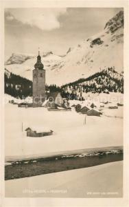 AK / Ansichtskarte Lech_Vorarlberg Kirche Winter Lech Vorarlberg