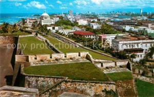 AK / Ansichtskarte San_Juan_Puerto_Rico Antiguas murallas de El Castillo San Cristobal Ciudad de San Juan al fondo San_Juan_Puerto_Rico