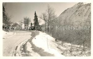 AK / Ansichtskarte Alaska_US State Highway in Winter