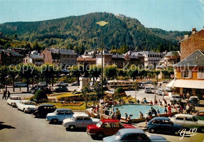 AK / Ansichtskarte La_Bourboule Place M. Bouchaudy Jet d eau Hotels La_Bourboule 0