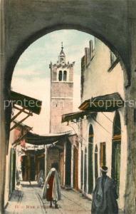 AK / Ansichtskarte Tunis Une rue dans la ville Tunis