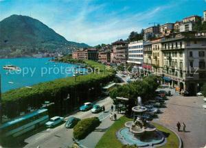 AK / Ansichtskarte Lugano_Lago_di_Lugano Panorama mit Blick zum Monte San Salvatore Lugano_Lago_di_Lugano