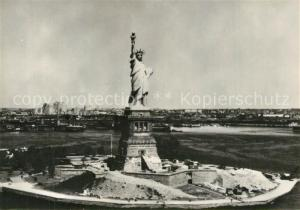 AK / Ansichtskarte New_York_City Statue of Liberty in front of New York Harbour aerial view New_York_City