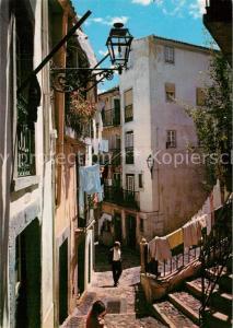 AK / Ansichtskarte Lisboa Rua tipica de Alfama Lisboa