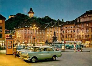 AK / Ansichtskarte Graz_Steiermark Hauptplatz Schlossberg Uhrturm Nachtaufnahme Graz_Steiermark