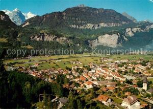 AK / Ansichtskarte Meiringen_BE Panorama gegen Wetterhorngruppe Berner Alpen Fliegeraufnahme Meiringen BE