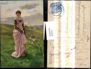 264372,Künstler Ak E. Niczky Wenn der Lenz erwacht Frau a. Wiese Dorf i. Hintergrund Landschaft