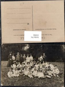 354982,Foto Ak Gruppenbild Kinder Uniform m. Erwachsene Lehrer Schule