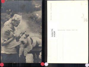 418289,Foto Ak Frau Lesen Schreiben Hund auf Tisch liegend